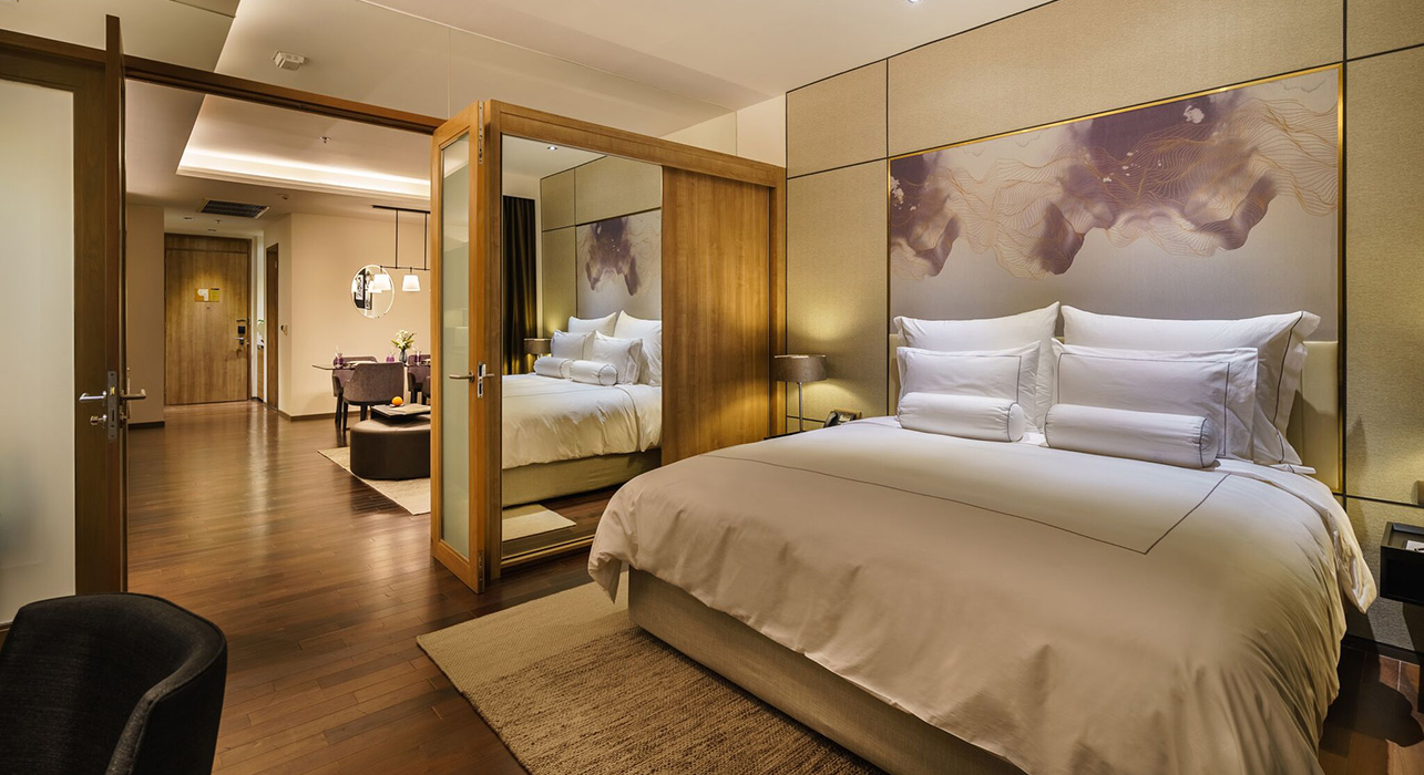 Luxury king sized bed in hotel suite - akyra Thonglor Bangkok